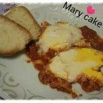 Uova con salsa di pomodoro e provola…per un secondo sfizioso, veloce e gustoso.