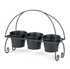 Adding cheer to your living space is as easy as 1-2-3! This adorable planter trio features three black metal planter pots that nestle into a scrolling black metal frame. Perfect for your patio table, porch, or anywhere you could use a triple dose of greenery. Plant your favorite blooms and enjoy!