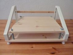 IKEA hack: Bookbinding loom for sewing signatures together.
