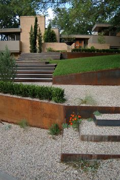 Cor-Ten steel as retaining walls and to define stairs. Rusts evenly to create warmth with clean, modern lines.