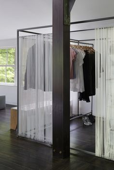 Makeshift closet in open living spaces