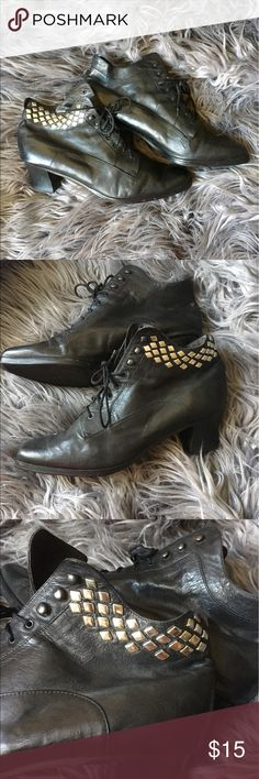 """Urban Outfitters black leather studded booties These awesome booties have been sitting in my closet for ages, silently judging me. I love them but haven't worn them - help me find them a good home! 😘 These booties are black leather, lace up, and have a heel of 2"""". They feature studs on the outside of each shoe, and can be laced all the way up or worn looser. I honestly don't think I've ever worn them, all signs of use are pictured and are from the store before I bought them. Let me know if…"""