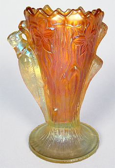 Millersburg carnival glass Woodpecker and Ivy vase.  Sold in 2011 for $15,000. http://www.morninggloryantiquescollect.com/