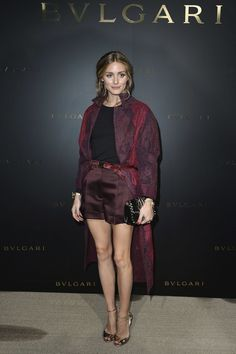 By belting her outerwear, Olivia Palermo ensures that her coat will stay in place all night and that it becomes a part of her whole ensemble. Win, win.