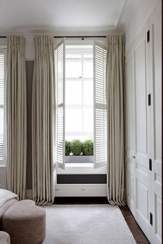 lovely neutral tone on tone bedroom with built-in closet, shutters, neutral drapes