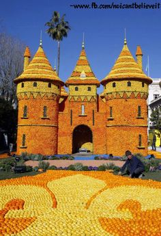 """Castle o'Fruit    Lemon festival in Menton, southern France. Some 145 metric tons of citrus fruits are used to make displays during the 79th festival, which is themed """"The Regions of France"""""""