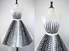 How swank is this!  1950s dress with detachable skirt to make it a leotard for swimming or tanning.  Love it!