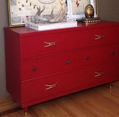 Rich red dresser with gold details by Roam Vintage Home