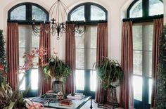 Drapery panels add a touch of elegance to functional roller shades.