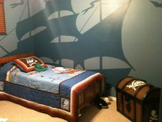 Little boy room - pirate theme!!! - bedding from target, treasure chest toy box created by my dad and wall mural by my sister :)