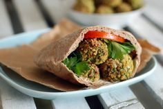 Baked, crunchy on the outside and filled with herbs - home made falafel served in a pita with tahini and tomato