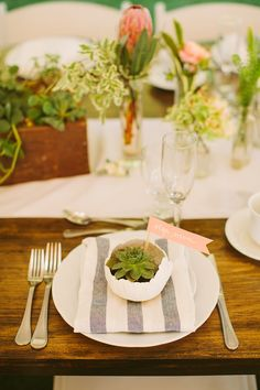 simple succulent place setting, photo by Rebecca Arthurs http://ruffledblog.com/rhode-island-beach-wedding #weddingideas #placesetting