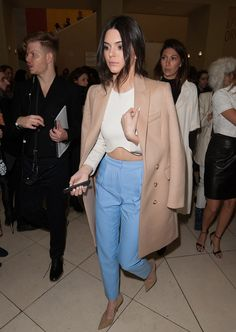 Kendall looking cool in trousers and a camel coat