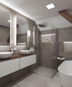 V podkrovní koupelně ATTIC stála designérka Simona před úkolem vtěsnat do necelých 7 m² dvě umyvadla, sprchový kout, solitérní vanu a ještě poskytnout dostatek úložného prostoru, to celé navzdory šikmině a trámu.Barevný a materiálový koncept... Grey Bathrooms Designs, Light Grey Bathrooms, Gray And White Bathroom, Bathroom Design Luxury, Bathroom Interior, Bathroom Trends, Bathroom Renovations, Bad Inspiration, Bathroom Inspiration