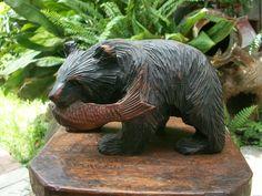 1930s Japanese Indigenous Hokkaido Ainu People Wood Carving of A Higuma Bear Holding A Salmon by PaulsJunkCloset on Etsy https://www.etsy.com/listing/243551101/1930s-japanese-indigenous-hokkaido-ainu