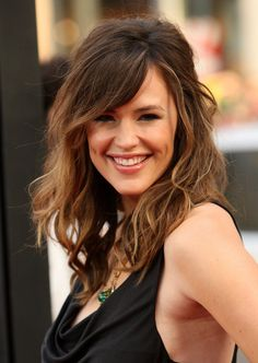 Love the style, cut and color! Brunette with subtle hombre highlights, side swept bangs, waves, and long layers.