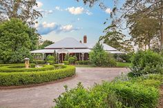 in Crows Nest, Australia. Historic Australian Homestead nestled in the High Country just 45 minutes north of Toowoomba on the crest of the Great Dividing Range. Beautiful gardens to unwind and take a break with country style hospitality. Located in a  flower farming precin...