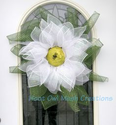 A personal favorite from my Etsy shop https://www.etsy.com/listing/229484061/daisy-wreath-deco-mesh-daisy