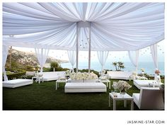Outdoor wedding reception with draped tent