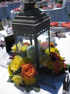 Lantern centerpieces. Small flower arrangments around lantern!