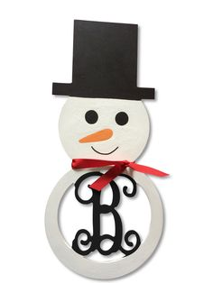 Painted Snowman Wood Initial Monogram Door Wreath Decoration Holiday Decor Gift Winter Decor by TheLetterBoutique on Etsy https://www.etsy.com/listing/217215611/painted-snowman-wood-initial-monogram