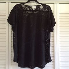 Black floral tee Really cool tee! It's a black tee with a floral pattern. It's sheer. If you wear a colored cami under it, the shirt will really pop. New with tags. Ava & Viv Tops Tees - Short Sleeve
