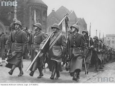 "Officers and enlisted soldiers of the 57th ""Greater Poland"" Infantry Regiment marching down the streets of Poznań at the 1937 Polish Independence Day Parade."