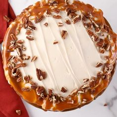 This decadent caramel poke cake will get you in the fall baking spirit. With yummy cream cheese frosting and salty toasted pecans, we think this is the perfect poke cake recipe for the fall season. #falldessert #caramelpokecake #creamcheesefrosting #thanksgiving #bhg Fall Desserts, Delicious Desserts, Yummy Food, Sweet Recipes, Snack Recipes, Cooking Recipes, Yellow Squash Recipes, Poke Cake Recipes, Fall Baking