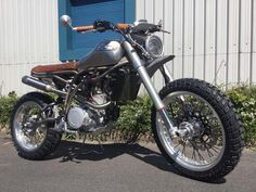 """British marque CCM Motorcycles is getting some much-deserved press for its new 600cc """"Spitfire"""" street bikes, which use a single-cylinder thumper from SYM. The company's roadster model has already caused quite a stir, and now CCM is showing off its scrambler variant, which features of courseknobby dual-sport tires. The bulk …"""