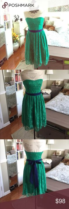 Anthropologie dress Beautiful green lace dress with a navy blue dash which ties to the back, can be removed if needed. Length is approximately 29 inches, however, the bottom of the dress is in straight as depicted in the pictures. Waist is approximately 25 inches around. Worn once. In great condition. @B Anthropologie Dresses