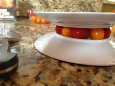 Cutting cherry tomatoes in half.