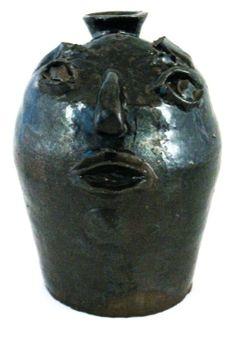Rare strap handled stoneware face jug ca. 1900: Lot 58