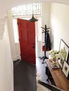 Red door painted in Rapture CC-66 (recommended product: Benjamin Moore's Grand Entrance in a Satin or High Gloss finish)