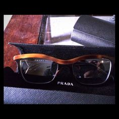 Authentic Prada glasses. Very unique. Brand new. Love these cat eye glasses. They do not have a prescription so cannot wear. They fit amazingly. Black and brown. Great deal. Prada Accessories Glasses