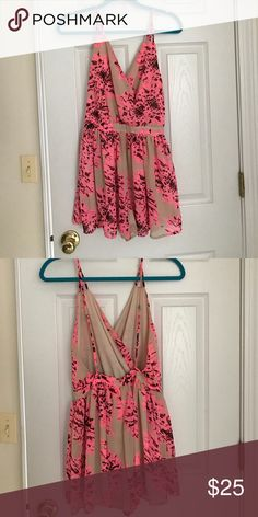 Francesca's pink floral romper Pink and beige flowy romper from Francesca's. adjustable straps, zipper back. (Straps are slightly frayed) Francesca's Collections Dresses