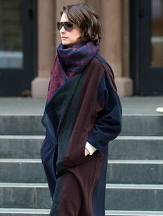Anne Hathaway keeps warm in New York with luxe blanket coat. via @WhoWhatWear