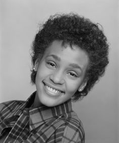 18-year-old Whitney Houston. One of her very first photo sessions. Taken at a time when she was singing in the church choir and taking the stage occasionally with her mother.