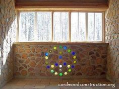 cord wood masonry with bottles. I'm going to build a cord wood house in the mountains Brick In The Wall, Brick Wall, Natural Building, Green Building, Cordwood Homes, Bottle Wall, Bottle House, Green Living Tips, Got Wood