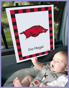 We start young...woo pig sooie!!!..too cute!!!!  Baby is already calling those Hogs!
