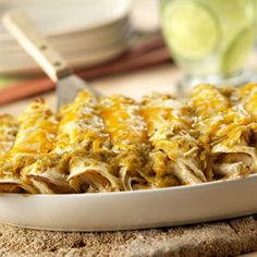Warm tortillas are filled with an enticing combination of shredded chicken, Pace® Salsa Verde, sour cream and Cheddar Jack cheese, and are baked until the filling is hot and the cheese is melted.