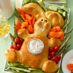 Easter Bunny Bread Recipe ~ With its toothy grin, lovely golden crust and tummy that's perfect for serving dip, this charming rabbit is sure to bring a smile to guests young and old!