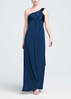 This long jersey dress is right on trend with the one shoulder strap. It has charmeuse on the bust and straps to give this dress some polish, while a long cascade back adds a goddess feel to the look. This dress can be dressed up or down depending on the event. Available in extra length sizes. Available in sizes 0-30. Dry clean only.