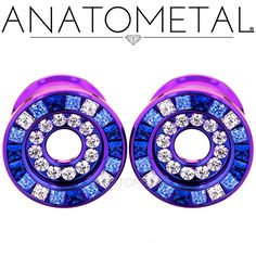 """1/2"""" Double Orbit Eyelets in ASTM F-136 titanium, anodized blurple with synthetic Sapphire, Arctic Blue CZ, and CZ gemstones"""