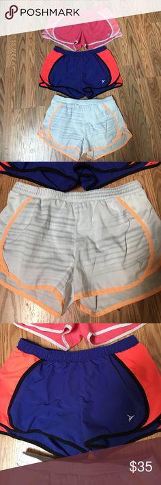 Lot of Old Navy running shorts Pink/light pink  Blue/bright orange White with gray stripes and light orange trim   All hardly worn and in excellent condition. Built in underwear. Reg $17/ea Old Navy Shorts