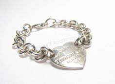 A sterling Silver Tiffany & Company Chain link bracelet with heart tag #tiffanyandco #tiffany #wickliffauction