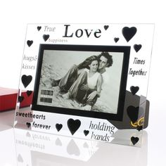 This stunning glass frame is decorated with a gorgeous mirror finish hearts design which is also surrounded by lots of loving and romantic words.