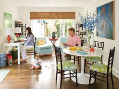 This sitting area and breakfast room just off of the kitchen offer a casual spot for the family to hang out. Toile fabric in bright hues on the chairs partners stylishly with a contemporary table from the inexpensive retailer IKEA. Budget-friendly finds mix seamlessly with antiques in this space. (Photo: Laurey W. Glenn)