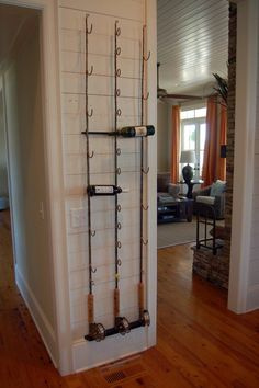 Fishing pole wine rack - Wonderfully clever for a lake house!