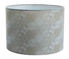 A great feature for any room, this neutral taupel lampshade in our hexie doodle fabric has been designed and made in our Devon studioAvailable in 2 sizes - 20cm diameter (18cm high) and 30cm diameter (21cm high). You may also choose whether we make your lamp with a pendant (hanging from the ceiling) or lamp (attached to the base from below) fitting - please make your selection from the menu. Pattern placement will vary.This quirky lampshade will make a wonderful addition to the home, or a…
