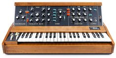 It's called a Moog, a minimoog to be exact.  How can you not want something called a Moog?